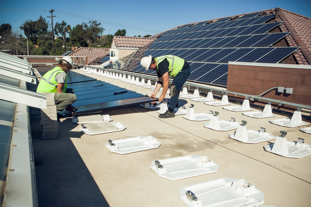 An installation of this type takes only two days. The Stion panels produce simiar power per square foot compared to crystalline silicone panels such as those in the background, yet they perform far better in hot conditions and under low or indirect light conditions, yielding 8% to 20% more power per watt of installed system capacity.